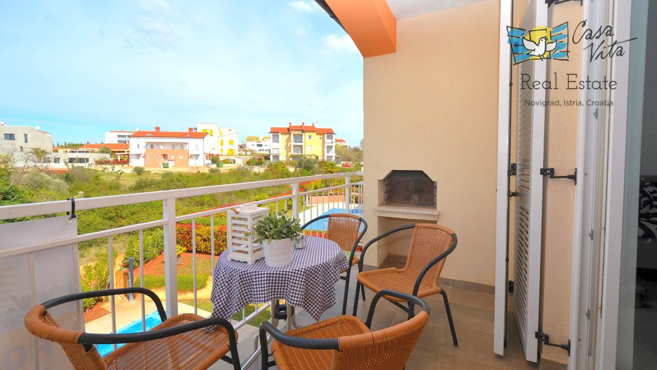 Apartment for sale in Novigrad with a beautiful view of the sea and the town of Novigrad.